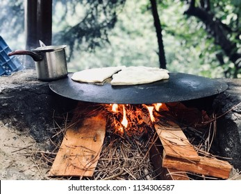 Turkish Food Gozleme Cooked in Wood Fire Pan in the Forest.