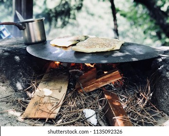 Turkish Food Gozleme Cooked in Wood Fire Pan in the Forest. Organic Food.