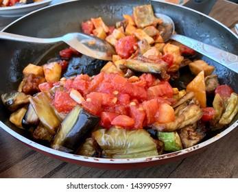 Turkish Food Kizartma / Fried Aubergine or Eggplant Slices with Tomato Paste Salsa Sauce and Cube Potatoes.