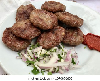 Turkish Food Kofte or Kofta / Stack of Meatballs with Onions and Hot Sauce. Kebab / Kebap