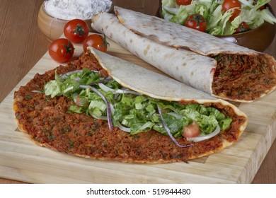 Turkish Food: lahmacun closeup on a wooden table. Horizontal