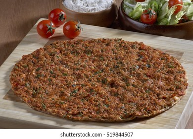 Turkish Food: lahmacun closeup on a wooden table. Horizontal
