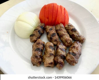 Turkish Food Meatball Kofte / Kofta with Tomatoes and Onion in Plate Portion.