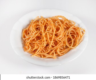 turkish food Top view of plate with spaghetti in tomato sauce on white background