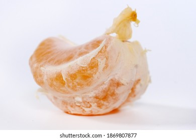 Turkish garden fruit Peeled tangerine or mandarin fruit isolated on white background cutout