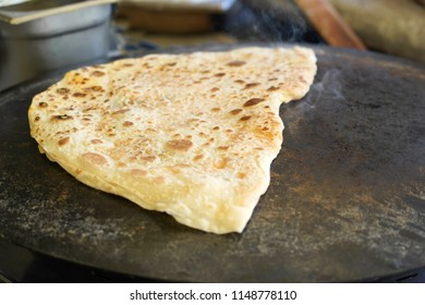 Turkish Gozleme.  Gozleme is a traditional Turkish dish featuring flat bread stuffed with a range of delicious fillings (cheese, patato, spinach, etc.) . Baked on sheet iron.