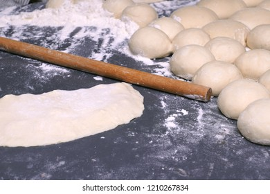 Turkish Gozleme.  Gozleme is a traditional Turkish dish featuring flat bread stuffed with a range of delicious fillings (cheese, ground meat, patato, spinach, etc.) Ready to be baking on sheet iron.