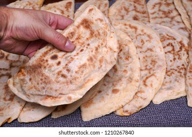 Turkish Gozleme.  Gozleme is a traditional Turkish dish featuring flat bread stuffed with a range of delicious fillings (cheese, ground meat patato, spinach, etc.). Baked on sheet iron.
