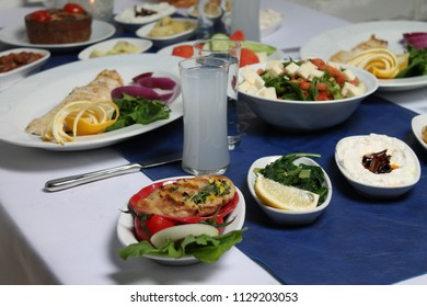 Turkish and Greek Traditional Dinning Table with Special Alcohol Drink Raki. Ouzo and Turkish Raki is a dry anise flavoured aperitif that is widely consumed in Turkey, Greece, Cyprus and Lebanon. Lo