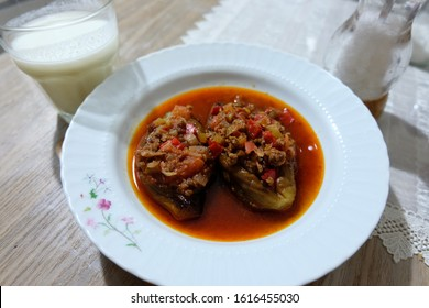 """Turkish and Greek traditional dishes.It is called """"Karniyarik"""", """"İmam Bayildi"""" or """"Patlican Musakka"""" in Turkish.Moussaka with eggplant and ground lamb or beef. It is served with Ayran or yoghurt. Meal"""