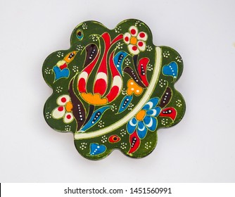 Turkish handcrafted colorful ceramic coaster isolated on clean white background