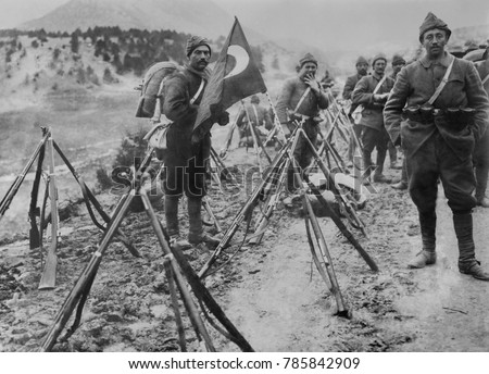 Turkish infantry column at rest with flag and rifles during World War I.
