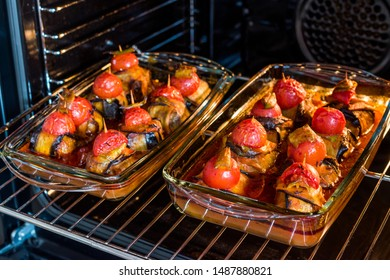Turkish Islim Kofta Kebab with Meatballs and Cherry Tomatoes Wrapped in Eggplant / Aubergine Slices on Oven Tray.