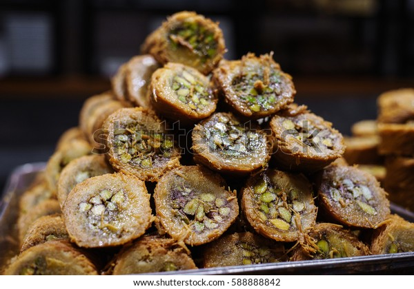 Turkish kadayif baklava sweet made with honey and pistachio nuts. Close. Laid in the shape of a pyramid or a hill