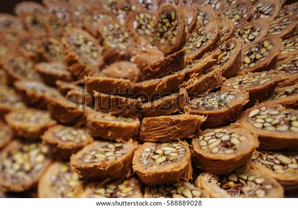 Turkish kadayif baklava sweet made with honey and pistachio nuts. Close-up. Laid on a plate with concentric circles