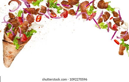Turkish Kebab yufka with flying ingredients. Freeze motion.