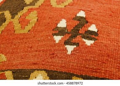 Turkish kilim with orange and brown zigzag pattern