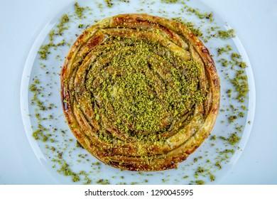 Turkish Konya Dessert Sac Arasi with Pistachio Powder / Kunefe Kadayif or Katmer