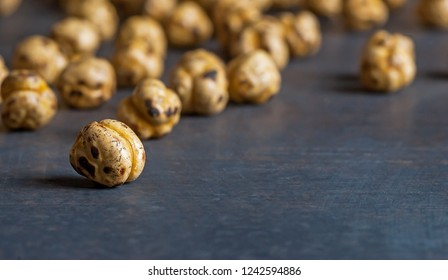 turkish leblebi, famous nut, close up yellow roasted chickpeas on black  rustic vintage wooden background