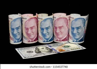 Turkish lira and American dollar bills. Turkish lira plunges, crashing. Turkey's lira crisis. Turkish lira is going down.
