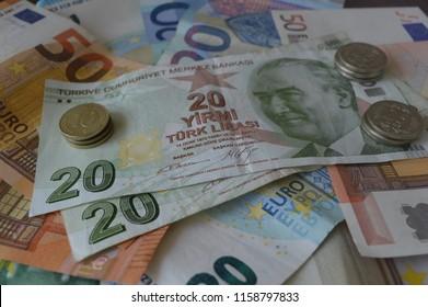 Turkish lira banknotes and coins on Euro banknotes.