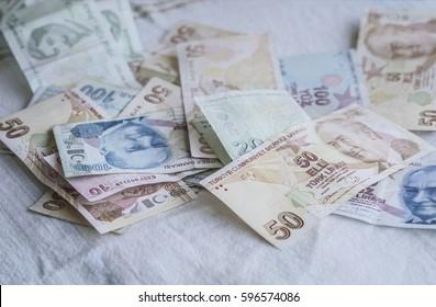 turkish lira banknotes on table