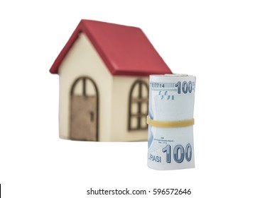 Turkish lira banknotes and small wooden house isolated on white