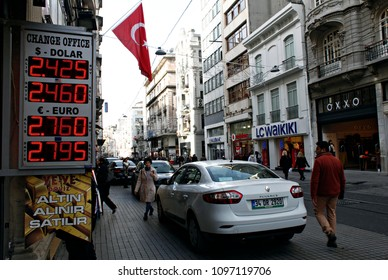 Turkish lira foreign exchange rates sit on display in the window of a currency bureau in Istanbul, Turkey, on Feb. 5, 2015
