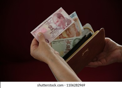 turkish lira on woman's hand, turkish currency, money,