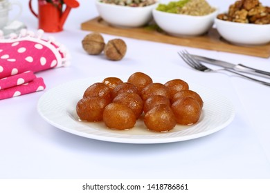 Turkish lokma dessert - Lokma is a Turkish fried sweet dough covered in a syrup and served