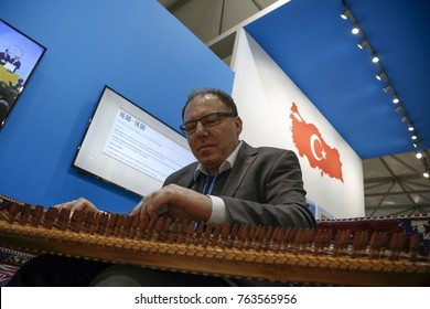 Turkish man plays qanun, traditional regional instrument at the COP23 Fiji panel in Bonn, Germany on the 15th of November 2017. COP23 is organized by UN Framework Convention for Climate Change.