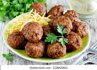 Turkish meatballs kuru kofte garnished with fried potato straws