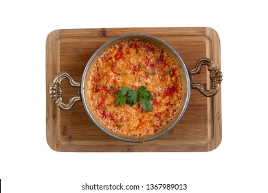 Turkish Menemen - Egg, tomatoes and pepper in pan isolated white background