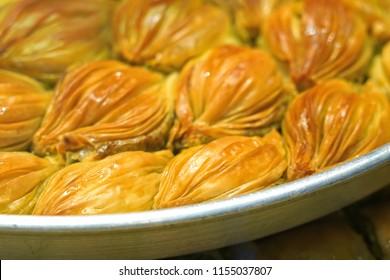 Turkish Midye Baklava  ( Mussel Shape Baklava ) with green pistachio nuts.