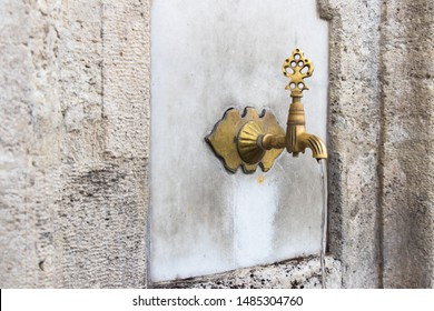 Turkish Ottoman style water tap at the ablution fountain in the courtyard of Fatih mosque