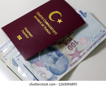 Turkish passport and Turkish Lira in the background.