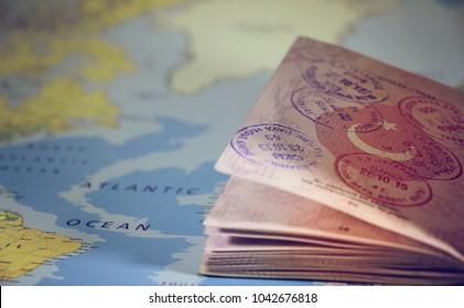 Turkish passport on world map. traveler concept and focus