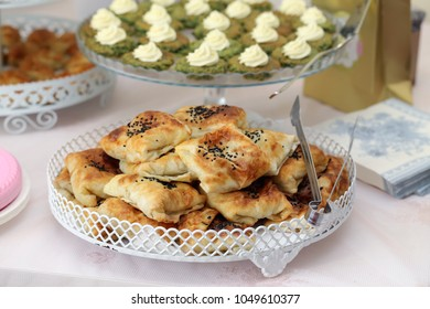 Turkish Pastry Borek with Sesame Seeds on party table