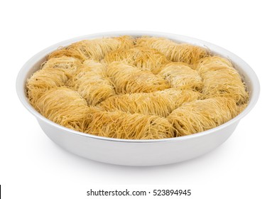 Turkish pastry cake kadaif pieces, traditional sweet, arranged in a baking pan isolated on white background