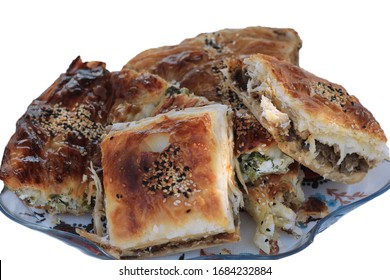 Turkish pastry with a plate of minced meat and spinach.
