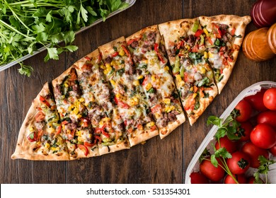 Turkish Pide with meat and vegetables.