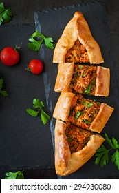 Turkish pide traditional food with beef and vegetables. Top view