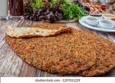 Turkish pizza concept on wooden table. Lahmacun in Turkish name; Meat bread