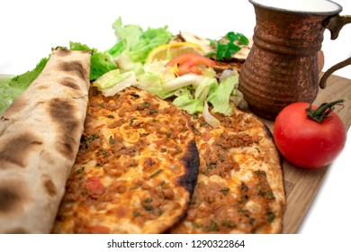 Turkish pizza, lahmacun, isolated on white background. lahmacun on a wooden table. Horizontal. one rolled with fresh garnish on the white surface.Cold buttermilk (ayran) near it.Close up taken,isolate