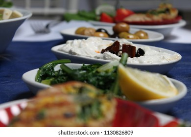 Turkish raki and Greek ouzo's feast. Tasty and healthy appetizers, yogurt, Roasted Peppers, olives, cheese, tomato, cucumber, herbs in the Aegean region.