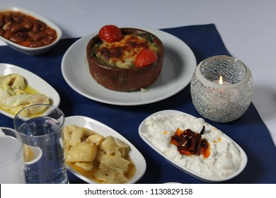 Turkish raki and Greek ouzo's feast. Tasty and healthy cold appetizers, yogurt, Roasted Peppers.