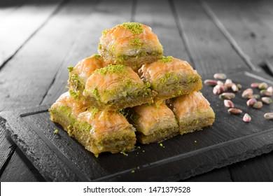 Turkish ramadan dessert Baklava with pistachio and black arabian tea.