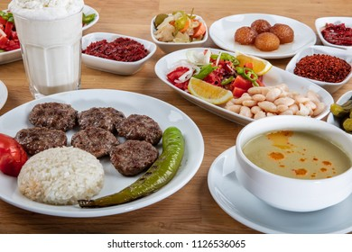 Turkish Restaurant Meatballs Menu (Kofte menu). On the table Meatballs, soups, desserts, ayran, salads, pickles, rice and spices