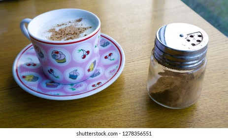 Turkish Salep or Sahlep with cinnamon on wooden table. Hot drink for warming up in winter season. Traditional milky hot drink in Middle East and Arabic culture. Protect from cold.