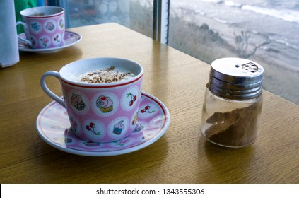 Turkish Salep or Sahlep with cinnamon on wooden table. Hot drink for warming up in winter season. Traditional milky hot drink in Middle East and Arabic culture.